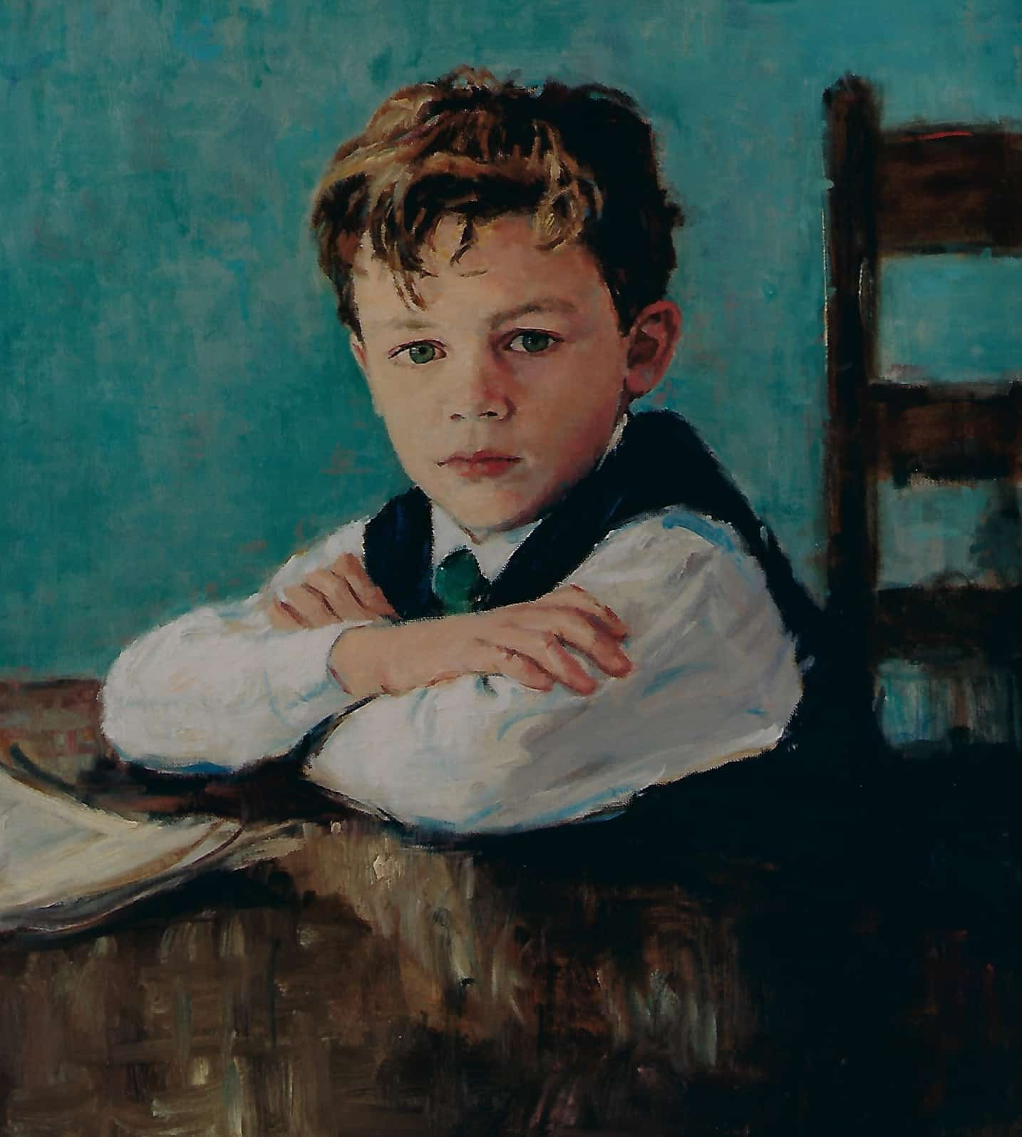 portrait of boy sitting at table